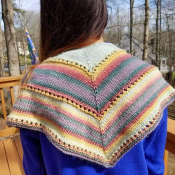 Lovely little hand knit springtime shawlette in mixed colors of merino wool and nylon blend.