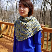 Lovely spring hand knit shawl in blue, green and yellow.