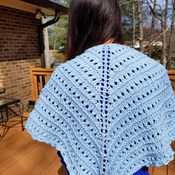 Lovely spring hand knit shawl in soft pastel blue made of organic cotton