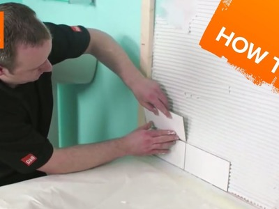 How to tile a bath splashback part 2: fixing the tiles