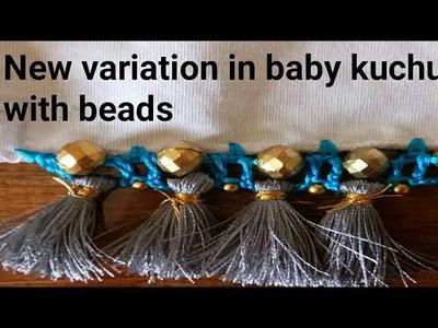 New variation in baby kuchu with beads Saree kuchu.saree tassel. edging  by Nidhi fashions
