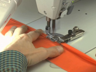 Learn How to Sew - Device for folding an edge of a fabric