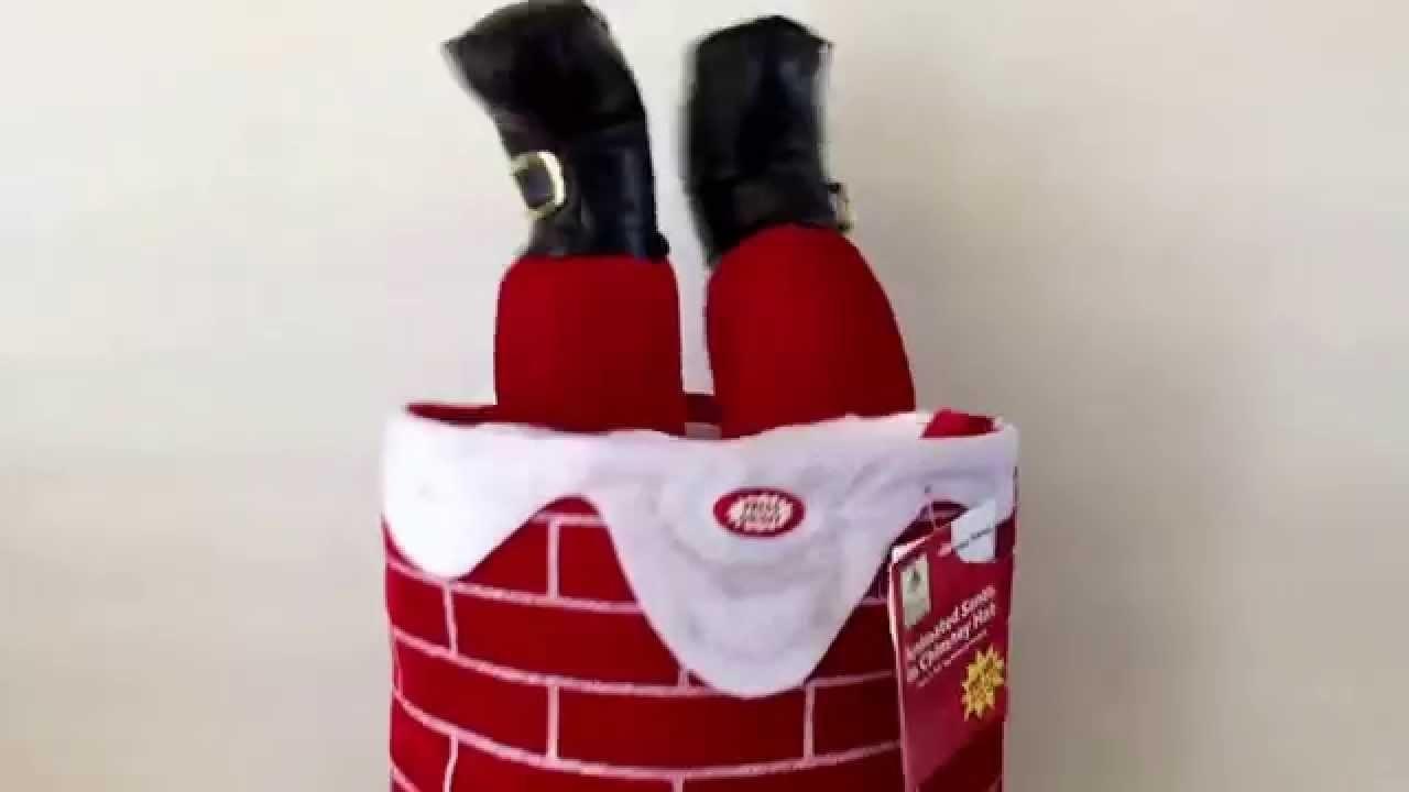 02e4c449ca6 Musical Moving Legs Santa Stuck in Chimney Talking Christmas Large Hat