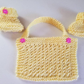 Hand knit Baby booties and bib set in bright yellow