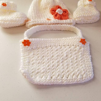 Hand knit Baby girl set with hat, bib and booties. White with orange accents