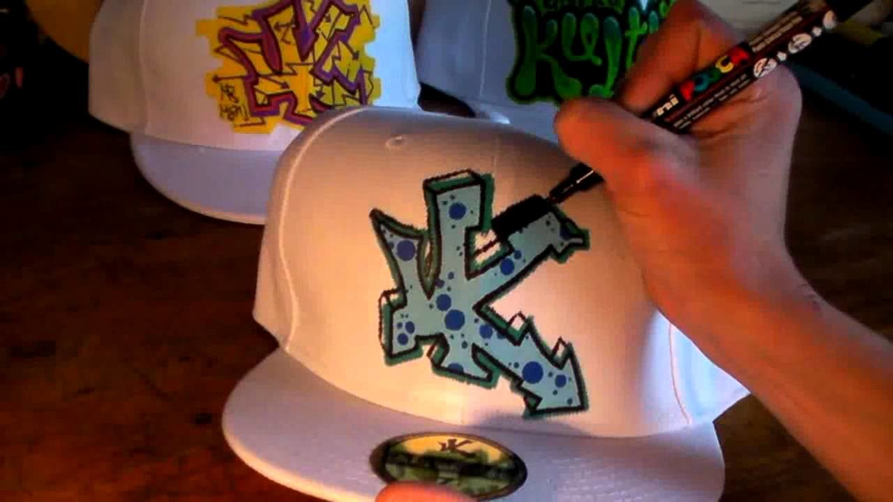 How to graffiti a hat 5 letters street art tag draw spray paint tutorial hip hop artist new era cap