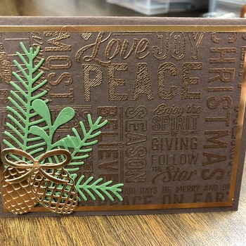 """Christmas"" Copper Embossing Word Background with Pine Cones/Boughs"