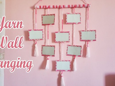 Diy yarn wall hanging. photo wall hanging