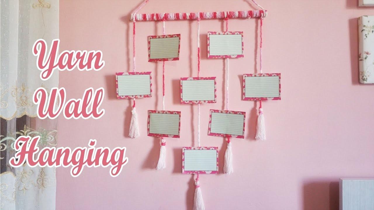 Diy yarn wall hanging. photo wall hanging