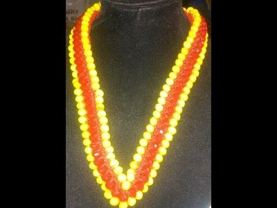 The tutorial on how to make this beautiful red and yellow beaded necklace.