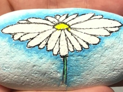 How to paint a watercolor effect on a rock with a daisy tutorial