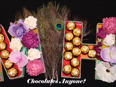 DIY Standing Letters table decor henna party ideas using Fererro Rocher