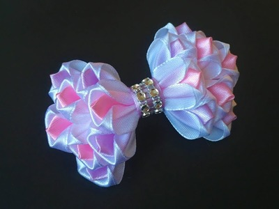 The decoration on the hairpin Kanzashi. Multicolor bow