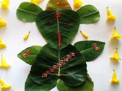 DIY How to make God Ganesh with leafs. Peepal Leaf Ganapathi. Easy Leaf Lord Ganesh