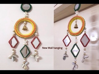 Wind chimes with bangles and wool.best out of waste.newspaper craft.wall hanging craft.DIY