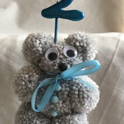 Hand crafted pom pom teddy bear and age cake topper