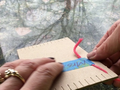 Warping a cardboard loom to make a pouch