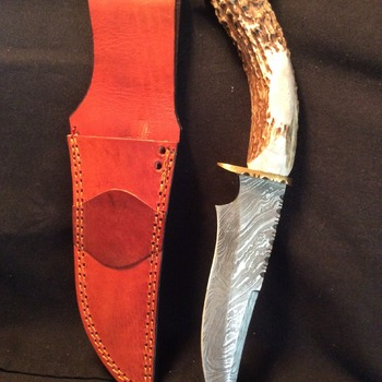 Frontier style deer handle knife with a damascus blade