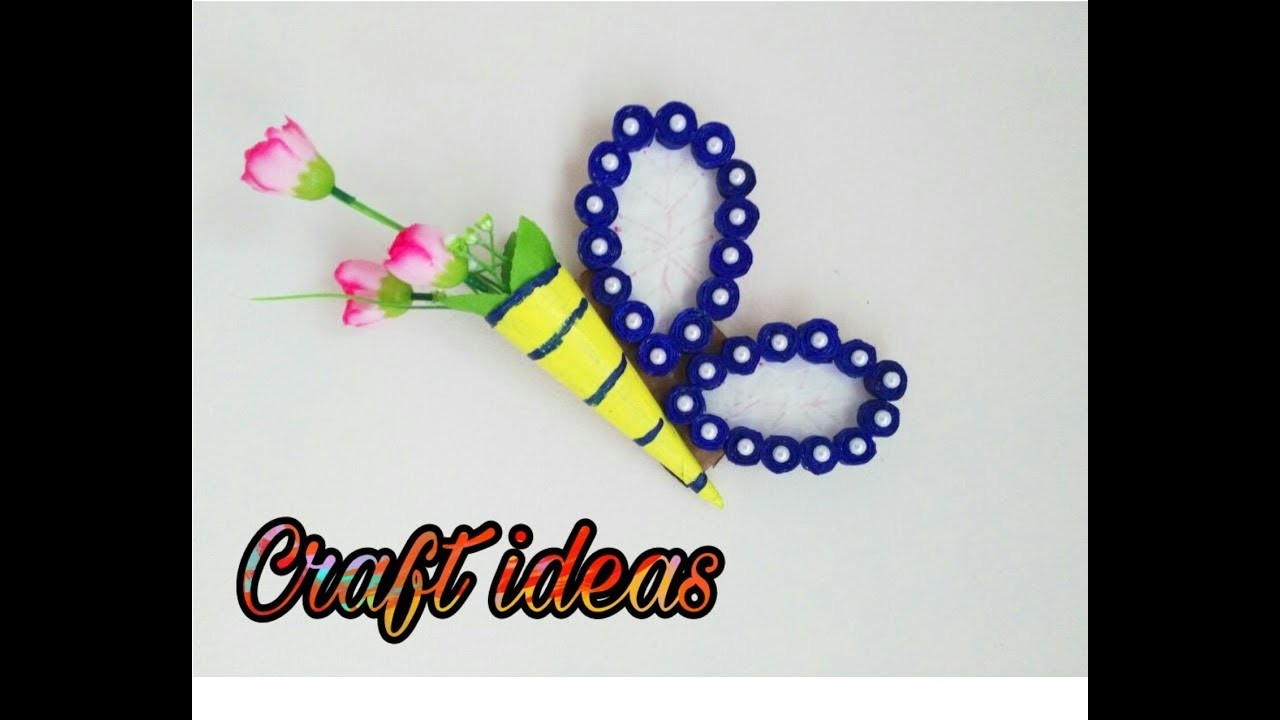 Paper craft wall decoration ideas best out of waste for Best out of waste paper ideas