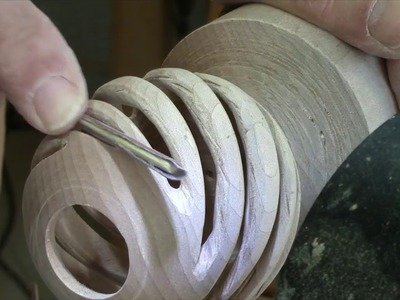 Woodturning a hollow spiral globe ornament