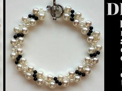 Pearl bracelet making.  How to make white and black bracelet.  Beading tutorial- very easy