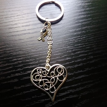Silver tone filigree heart key ring with charm