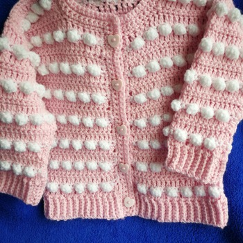 Small girls pink and white cardigan with gorgeous heart buttons