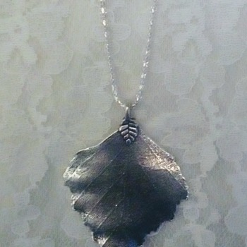 Silver colour pendant necklace.