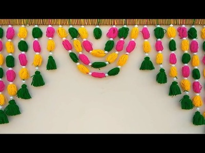A BEAUTIFUL TORAN FROM WOOLEN || DIY - HOW TO MAKE WOOLEN  DOOR HANGING TORAN AT HOME || DIY = TORAN