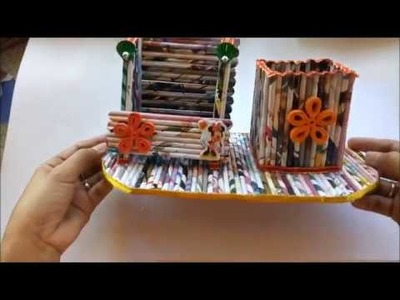 DIY Newspaper Cellphone and Charger Holder